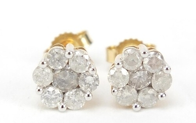 Pair of 9ct gold diamond flower head earrings, approximately...