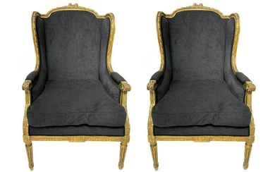 Pair of bergère armchairs in gilted wood, XX century.