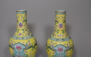 Pair of long neck porcelain vases with polychrome floral decoration on a yellow and turquoise background. Apocryphal Jiaqing mark.