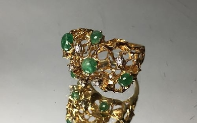 Ring embellished on a dysemetric fishnet with jade...