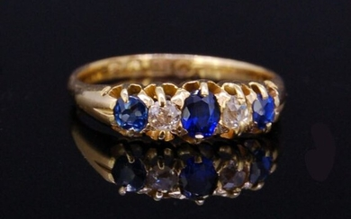 SAPPHIRE AND DIAMOND 5-STONE RING, set with 3...
