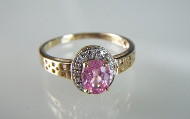 Solitaire oval Pink Topaz with Diamond accents set in a 9ct ...