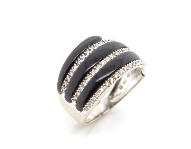 18ct white gold, diamond and onyx ring marked 750 18k. Appro...