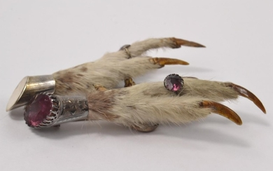 2 vintage rabbit foot brooches, 1 set with a purple stone in...