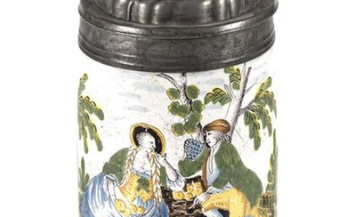 """A CRAILSHEIM """"YELLOW FAMILY"""" FAIENCE TANKARD, painted with a couple in a landscape C. 1770/80. Pewter mounts. Cracks. H. 17/20 cm"""