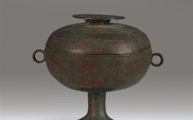 A Chinese archaic bronze ritual vessel and associated cover,...