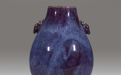 A Chinese flambe-glazed hu-form vase with deer-form handles Qing...