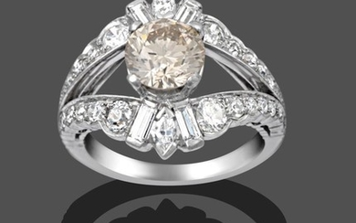 A Diamond Cluster Ring, the central fancy light brown round...