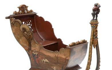 A Dutch polychrome painted and parcel-gilt carved wood sleigh