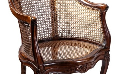 A French caned walnut bergère, 18th Century