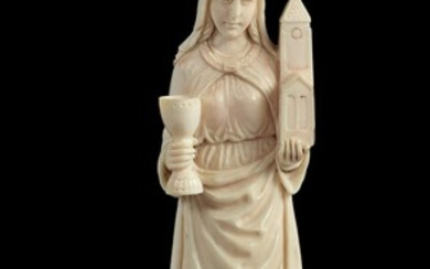 A French carved ivory model of a female saint in 14th century style