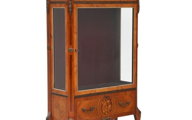 A Louis XV style rosewood display cabinet with inlays and bronze ornaments. Mid 20th century....