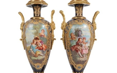 A Pair of Gilt Metal Mounted Sèvres Style Porcelain Vases...
