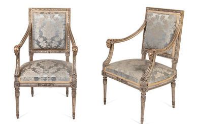 A Pair of Louis XVI Style Carved and Silver Paint Decorated Fauteuils