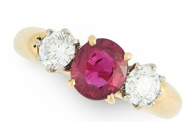 A RUBY AND DIAMOND THREE STONE RING in 18ct yellow