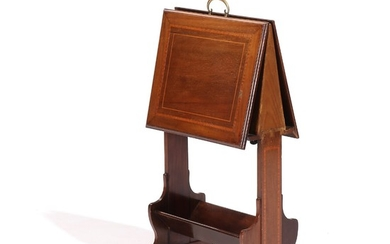 A Regency style mahogany magasine rack, inlaid with intarsia. Circa 1900. H. 84. L. 44. W. 22/55 cm.
