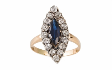 A SAPPHIRE AND DIAMOND NAVETTE CLUSTER RING, sapphire of app...