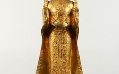 A TALL GILT BRONZE THAI STANDING BUDDHA. 34ins high.