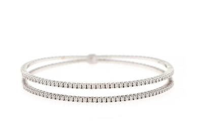 A flexible diamond bangle set with numerous brilliant-cut diamonds totalling app. 1.25 ct., mounted in 18k white gold. W/VVS.