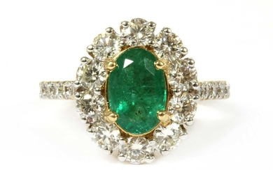 A gold emerald and diamond cluster ring