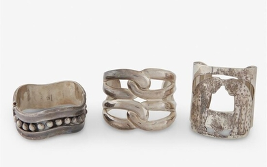 A group of sterling cuff bracelets, including Selini including...