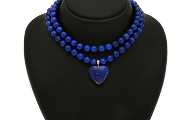 A lapis lazuli jewellery set comprising two clasps, two necklaces and a hinged pendant in the shape of a heart. (5)