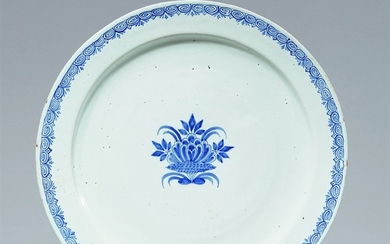 A large Berlin faience platter with a fanciful floral motif