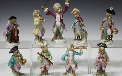 A nine-piece Volkstedt porcelain Meissen style monkey band, early 20th century, comprising eight mus