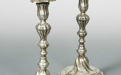 A pair of German metalwares cast candlesticks, and…