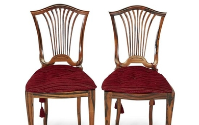 A pair of Regency style cane seat calamander side...