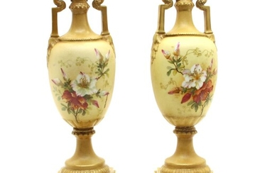 A pair of Vienna porcelain twin-handled urns on stands