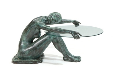 A patinated bronze coffee table with base in shape of a woman, glass table top. 20th-21st century. H. 60. L. 130. W. 83 cm.