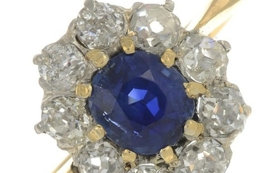 A sapphire and diamond cluster ring.With report 79231-75,...