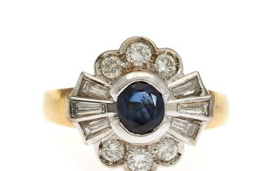 A sapphire and diamond ring set with an oval-cut sapphire encircled by six brilliant-cut and six trapez-cut diamonds, mounted in 18k gold and white gold.