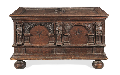A small early 17th century boarded oak chest, Flemish, circa 1600-20