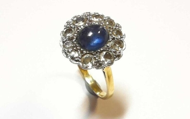 A star sapphire and diamond cluster ring