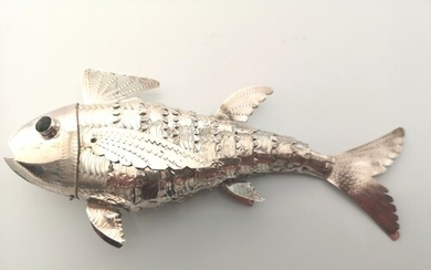 A sterling silver reticulated fish. Probably continental sta...