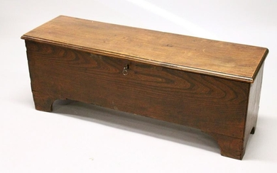 AN 18TH CENTURY ELM SIX PLANK COFFER, on bracket feet.