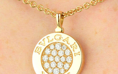 An 18ct gold diamond and onyx 'Roma' reversible pendant on chain, by Bulgari.