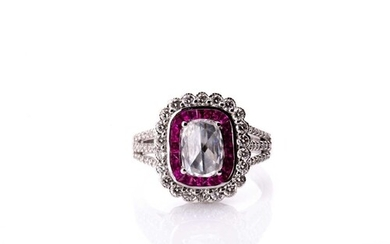 An 18ct white gold, diamond, and ruby cluster ring, set with...