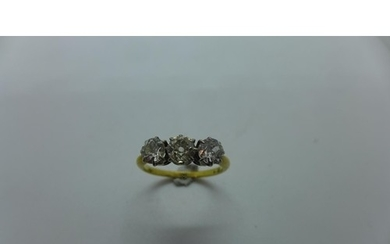 An 18ct yellow gold three stone diamond ring, claw set with ...