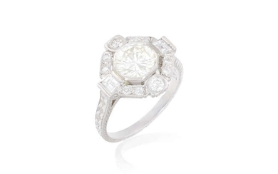 Description A DIAMOND DRESS RING The collet-set round brilliant-cut...