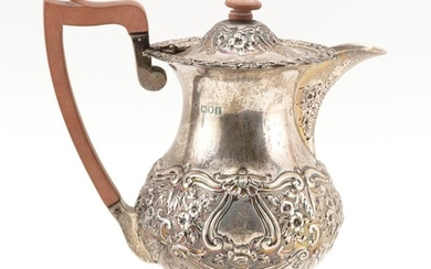 EDWARD VII STERLING SILVER HOT MILK JUG Wakely & Wheeler (James Wakely & Frank Clarke Wheeler), maker. Repoussé-decorated with flora...