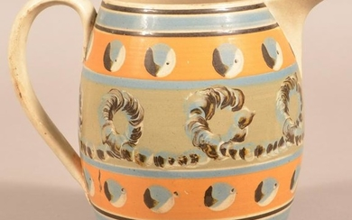 Earthworm and Cats Eye Mocha Decorated China Jug.