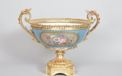 Large porcelain bowl in the taste of Sèvres, decorated on a blue background with gold leafed cartouches and polychrome flower bouquets, the white interior decorated with a garland of flowers and a bouquet. Beautiful ormolu gilt bronze frame chiselled...