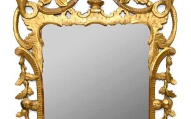 Mid-18th century Chippendale style pierced giltwood wall mirror with eagle cresting, 107 x 63cm