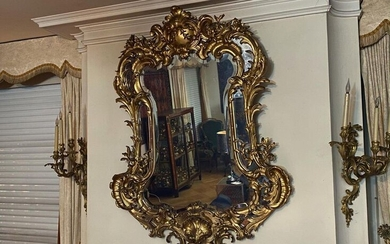 Mirror with brackets, in a moulded, carved and gilded wood...