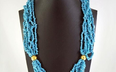Necklace of strands of turquoise and 18K gold beads