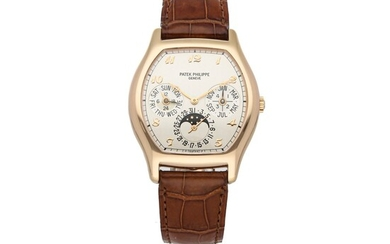 PATEK PHILIPPE | REF 5040R, A ROSE GOLD TONNEAU-SHAPED AUTOMATIC PERPETUAL CALENDAR WRISTWATCH WITH MOON PHASES CIRCA 2000