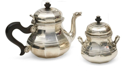 Pourer and sugar bowl in silver, model with sides and grooves, the spout in duck's beak, the handle in rosewood, the sugar bowl with two handles. Work of Puiforcat Gross weight of the pourer: 929.7 grams Height: 18.5 cl Weight of the sugar bowl: 538.2...
